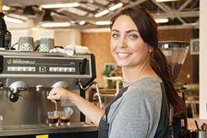 Local Barista Fills Cups and Hearts